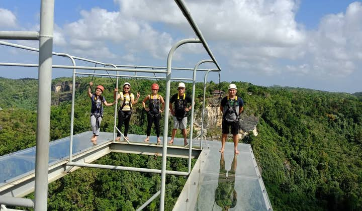 Tourists partaking in the Cliff-Glass Walk at Danao Adventure Park