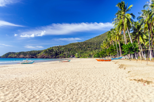 White sand and clear waters of Nagtabon Beach in Palawan