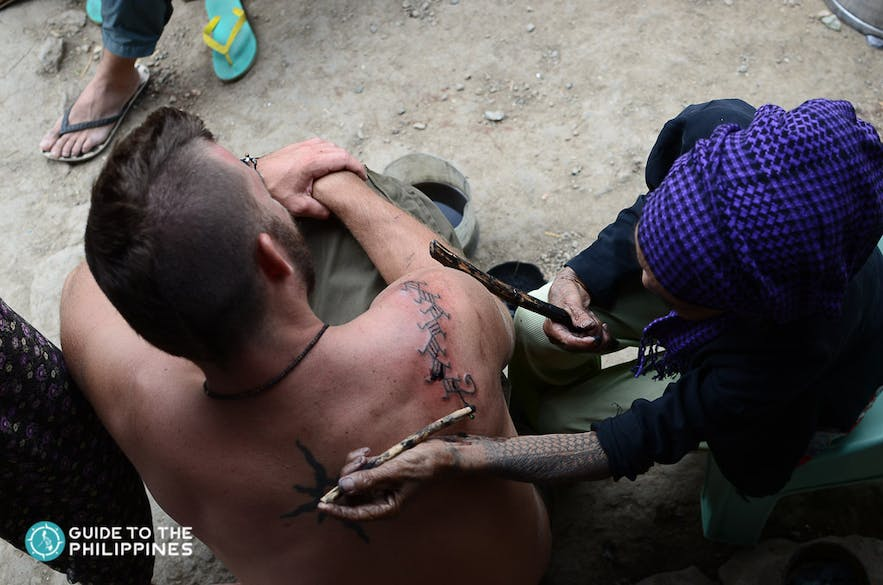 Traditional tattoo by Apo Whang Od in Buscalan, Kalinga