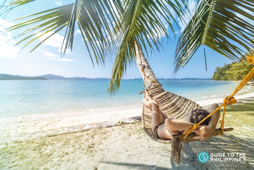Girl in hammock in El Nido, Palawan, Philippines