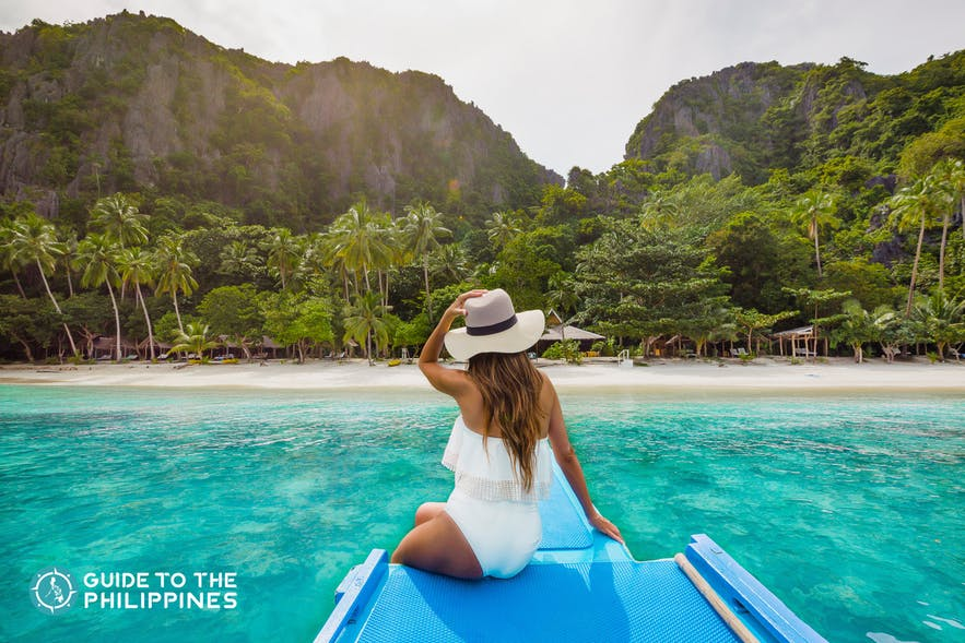 Female traveler on a boat in Palawan, Philippines