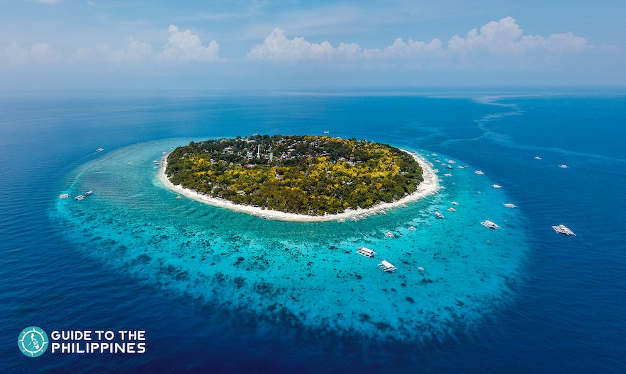 Balicasag Island is a popular diving site accessible from Alona Beach, Bohol.