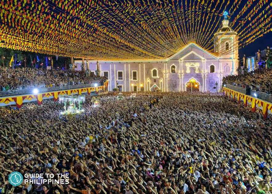 Devotees at the solemn procession during Sinulog Festival in Cebu, Philippines