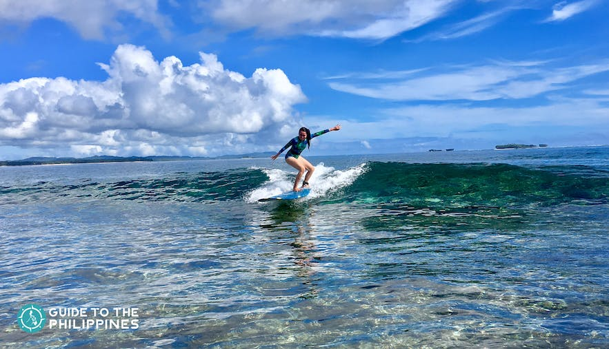 Girl during surfing season in Siargao, Philippines