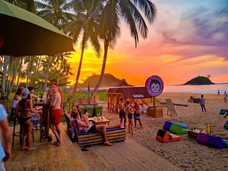 Sunset view at Mad Monkey Hostel Nacpan Beach in El Nido, Palawan