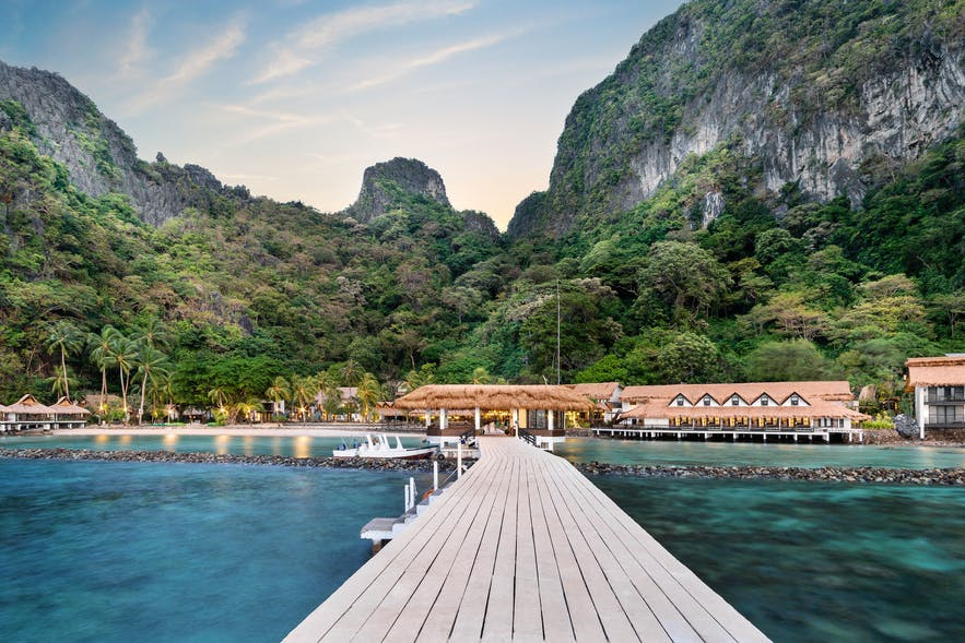 Water cottages at dawn in Miniloc Island, El Nido