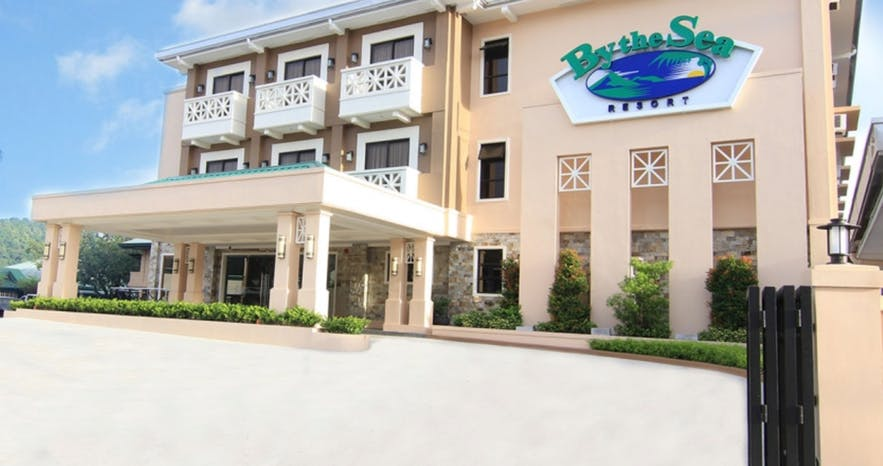 Facade of By the Sea Resort Hotel