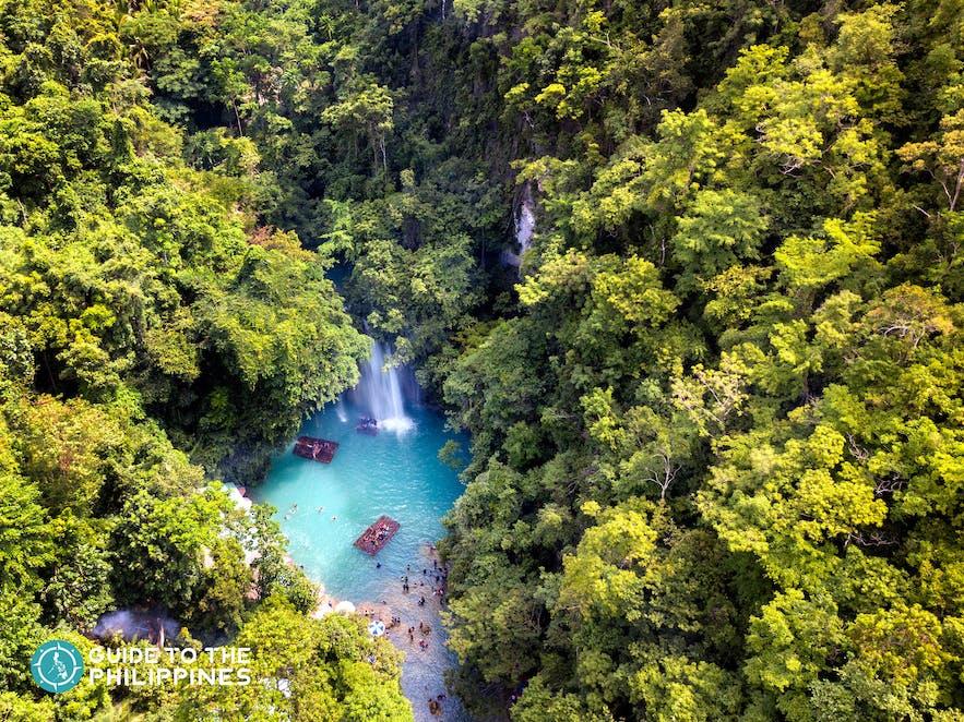 Aerial view of Kawasan Falls with many travellers