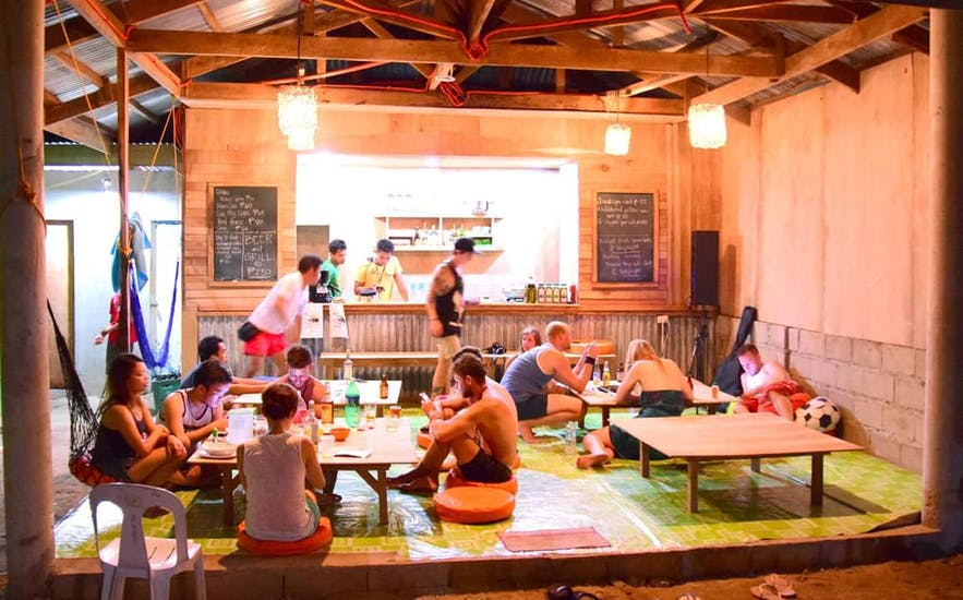 Travelers bonding together in Malapascua Budget Inn