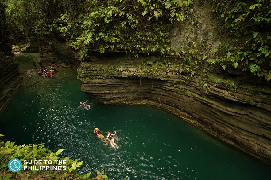 People canyoneering to Kawasan Falls
