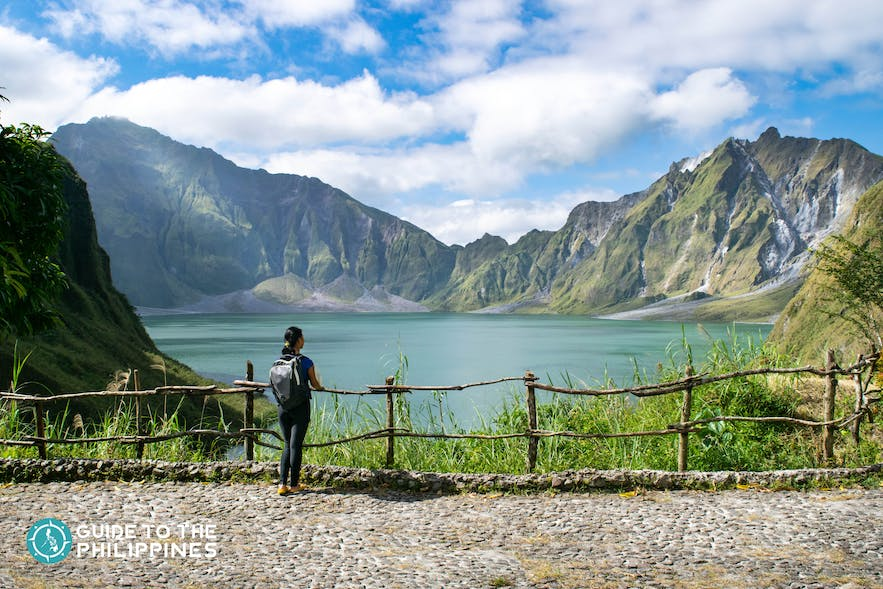 Female traveler enjoying the view of Pinatubo Lake
