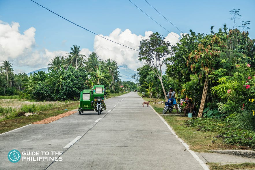 Tricycle bringing travelers around the Catanduanes neigborhood