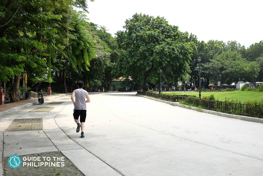 Man jogging in Quezon City Memorial Circle