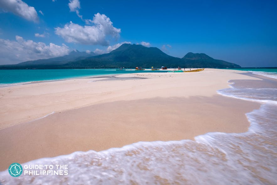 White sand and clear waters of White Island in Camiguin