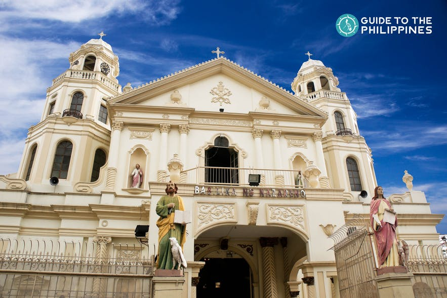 The façade of Quiapo Church, built in the baroque style, stands out from both sides with its rolling towers