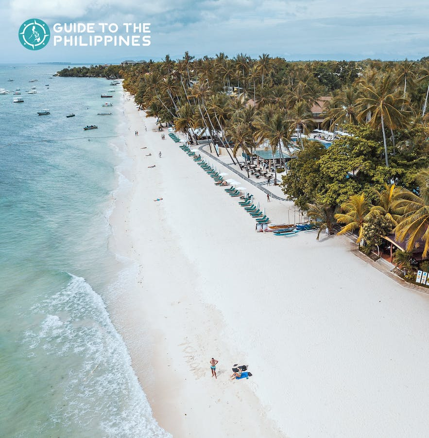 Aerial view of travelers by Alona Beach in Panglao, Bohol