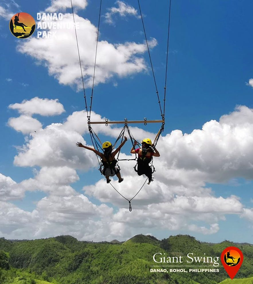 Female travelers enjoying the Giant Swing at Danao Adventure Park in Bohol, Philippines