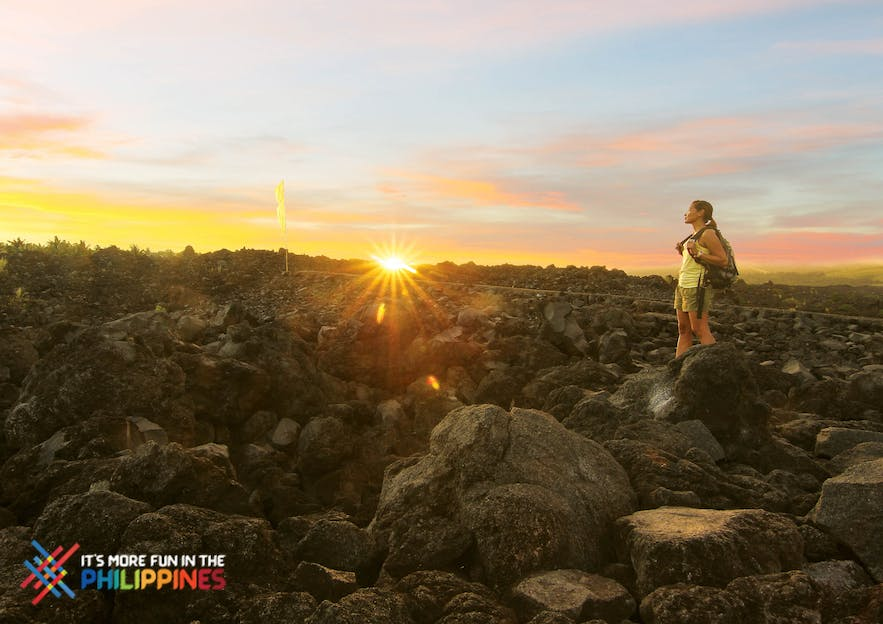 Female traveler hiking at the base of Mt. Mayon in Legazpi, Albay