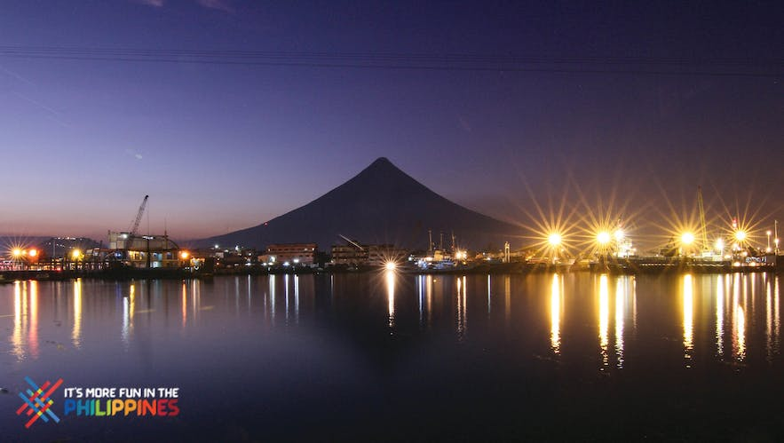 View of the Embarcadero de Legazpi with the silhouette of Mt. Mayon at night