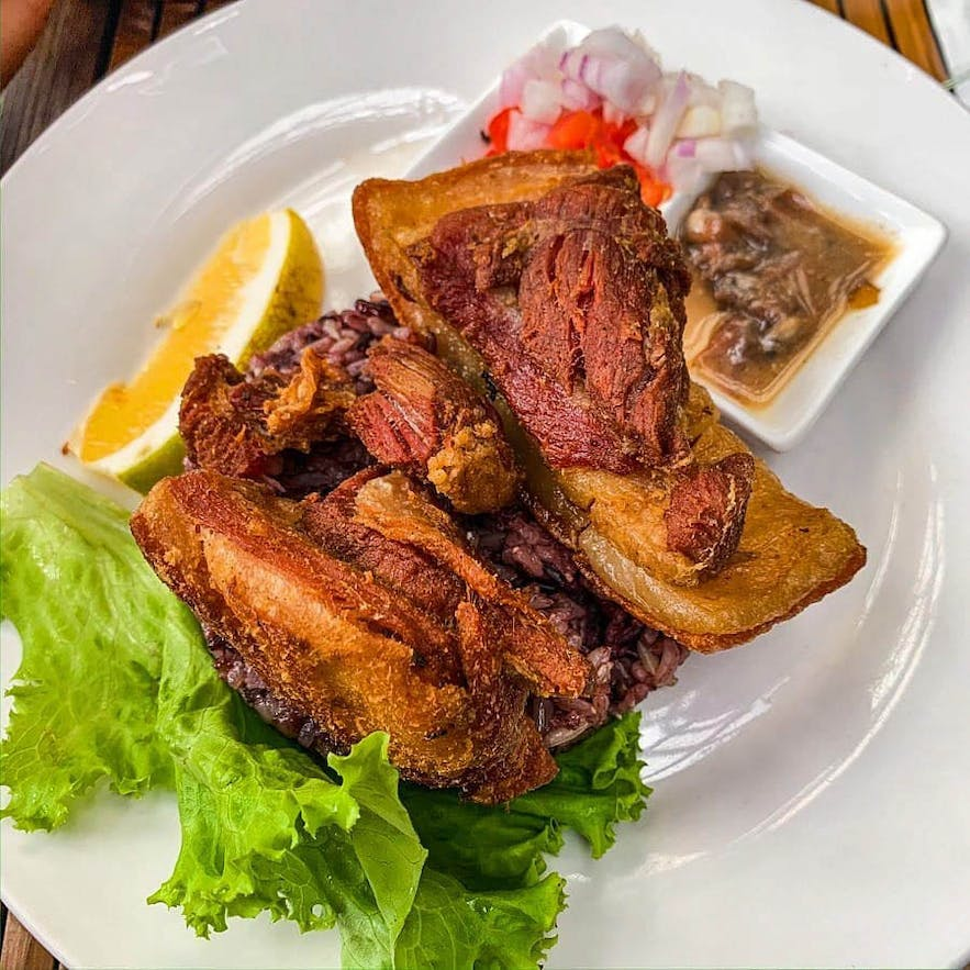 Baguio Bagnet, double fried pork belly paired with padas bagoong and fresh tomato onion relish