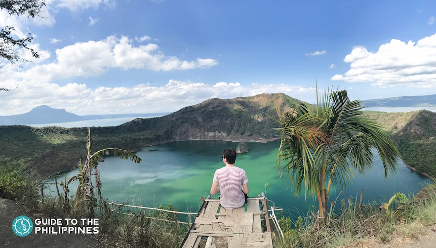 Traveler enjoying the view of Taal Lake and Volcano in Tagaytay, Philippines