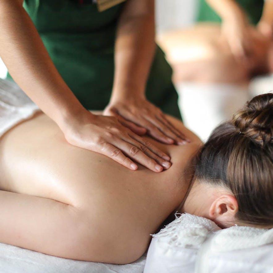 A woman getting a massage at Nurture Wellness Village in Tagaytay
