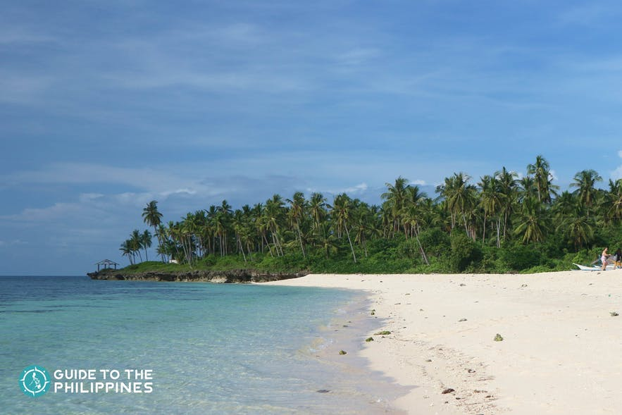 White sand shore of Bakhaw Beach in Camotes Islands
