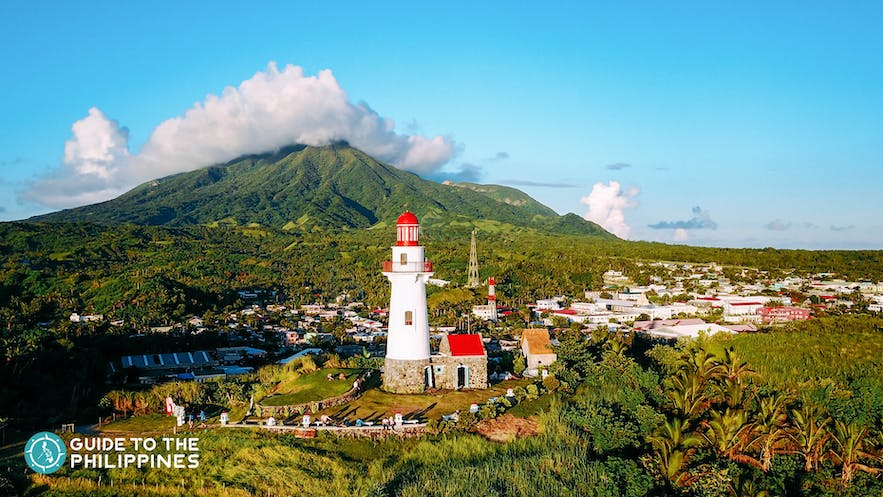 Sunset view of Mt. Iraya featuring the Basco Lighthouse of Batanes