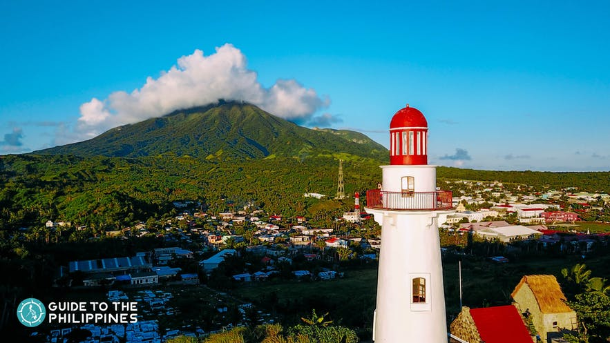 Basco Lighthouse in Basco, Batanes with Mt. Iraya in the background