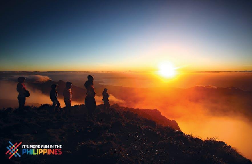 Travelers trek to catch the sunrise at Mt. Apo, the highest peak in the Philippines