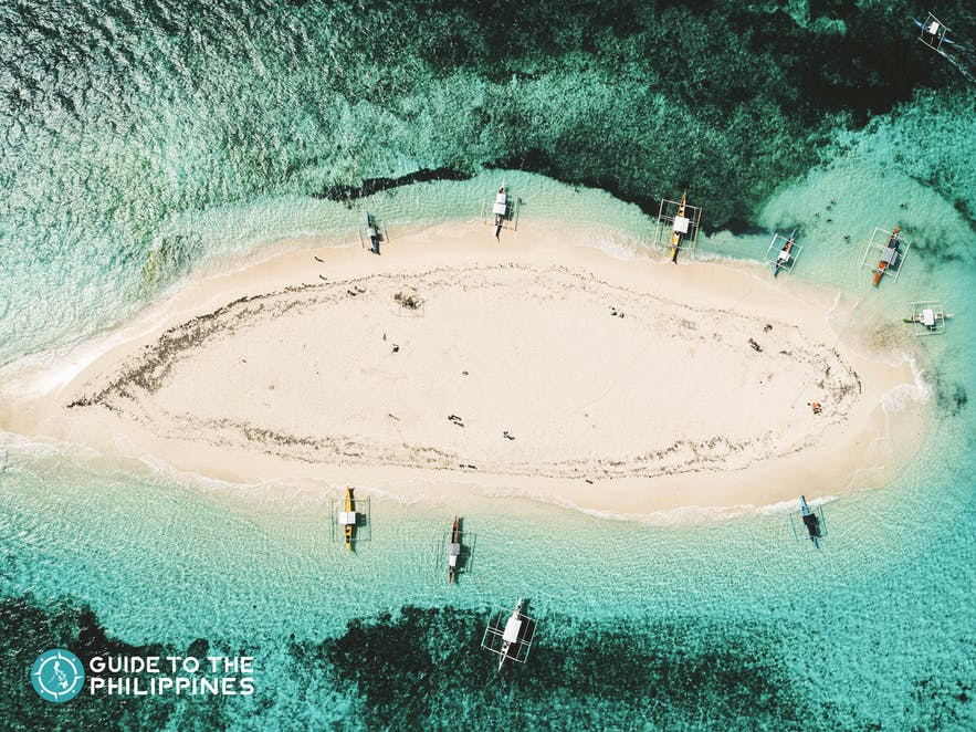 Top view of Siargao's Naked Island and its surrounding turquoise waters
