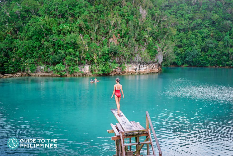 Girl about to jump off into the Sugba Lagoon of Siargao