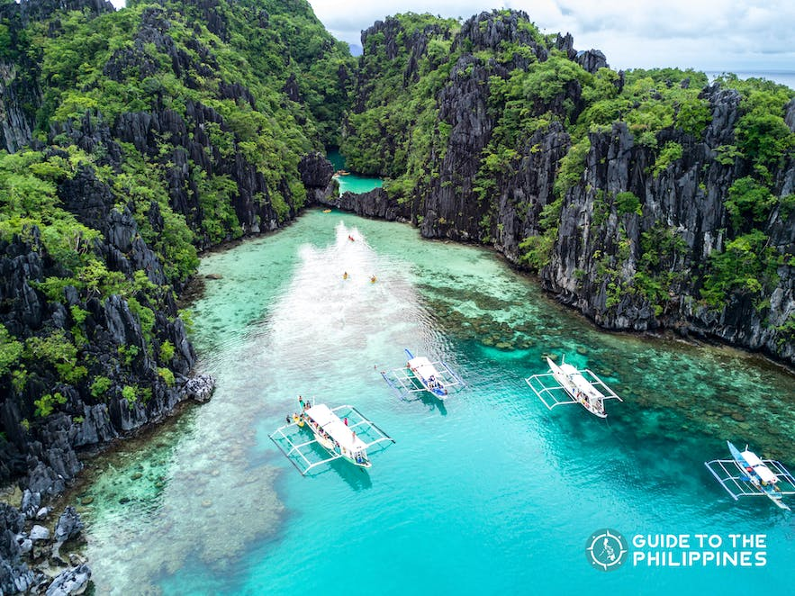 Palawan's limestone karst, white sand beach, and turquoise waters