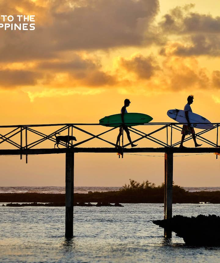Surfers and sunset at Cloud 9 in Siargao Island