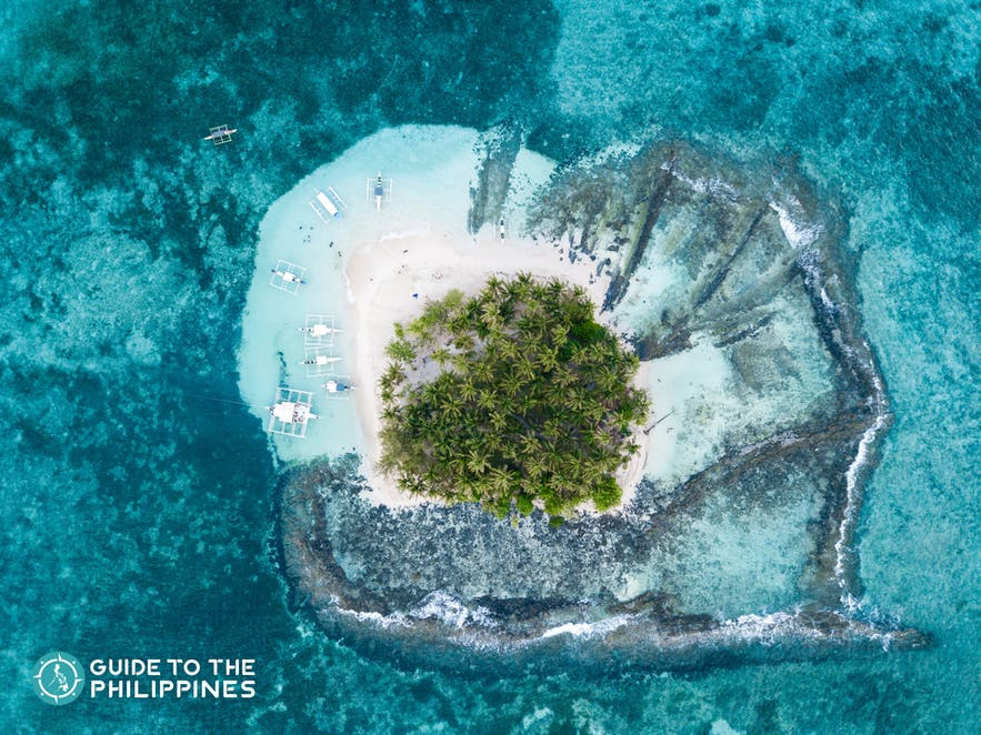 Top view seascape of Guyam Island in Siargao, Philippines