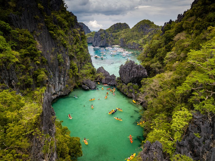 Travelers kayaking in El Nido, Palawan's Small Lagoon