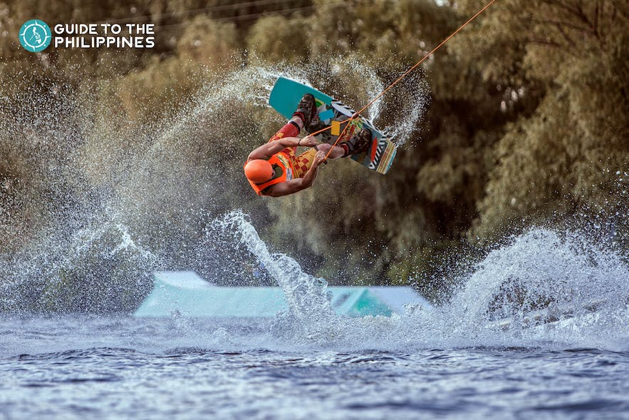 Man does an extreme jump on wakeboard