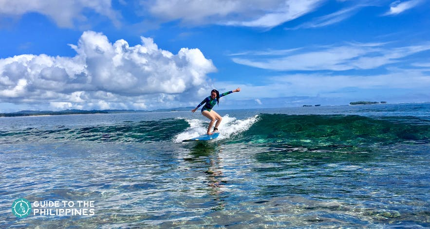 Surfer riding the waves of Cloud 9, Siargao