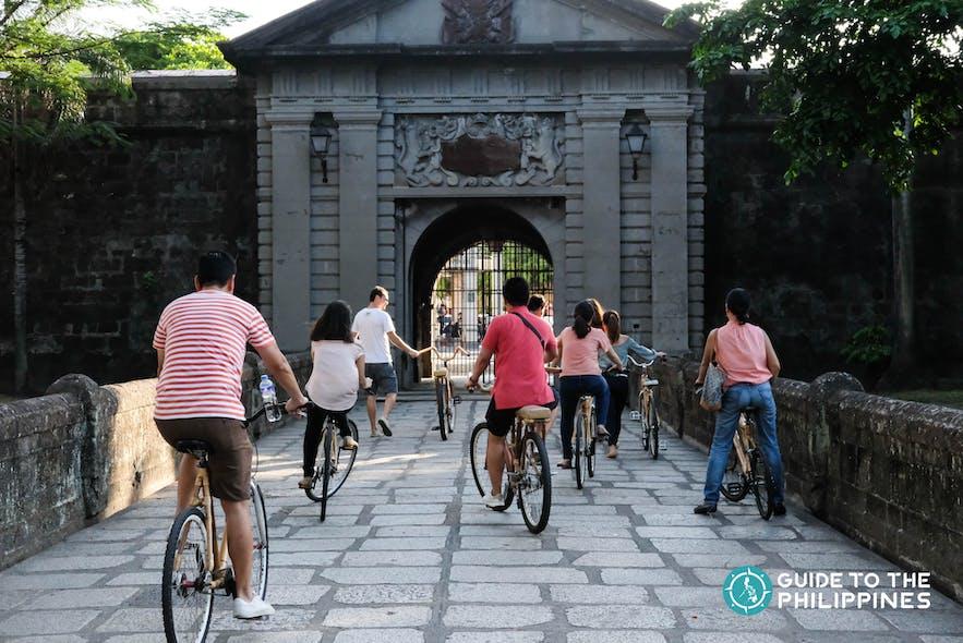 Travelers going around Intramuros using bamboo bikes
