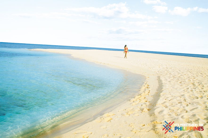 Woman enjoying the white island in Camiguin