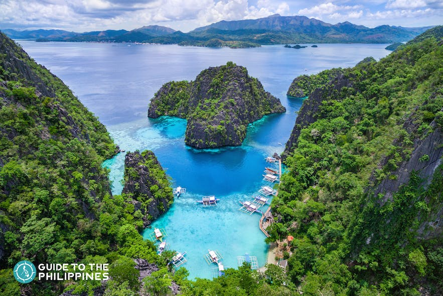 Coron's Twin Lagoon top view with limestone karts and clear blue waters