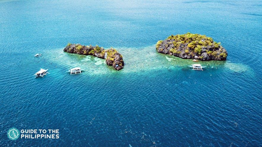 Aerial shot of boats at Siete Pecados in Coron, Palawan