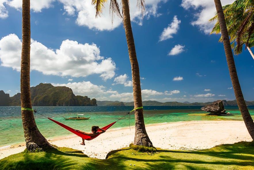 Lady in a hammock at a beach in El Nido, Palawan