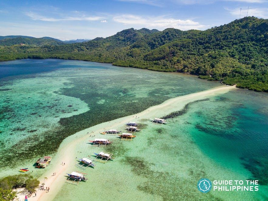 Aerial drone shot of boats at Snake Island in El Nido, Palawan