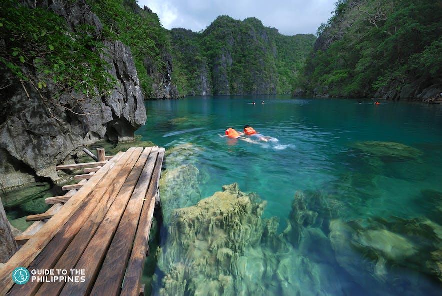 Travelers swimming at Kayangan Lake in Coron, Palawan