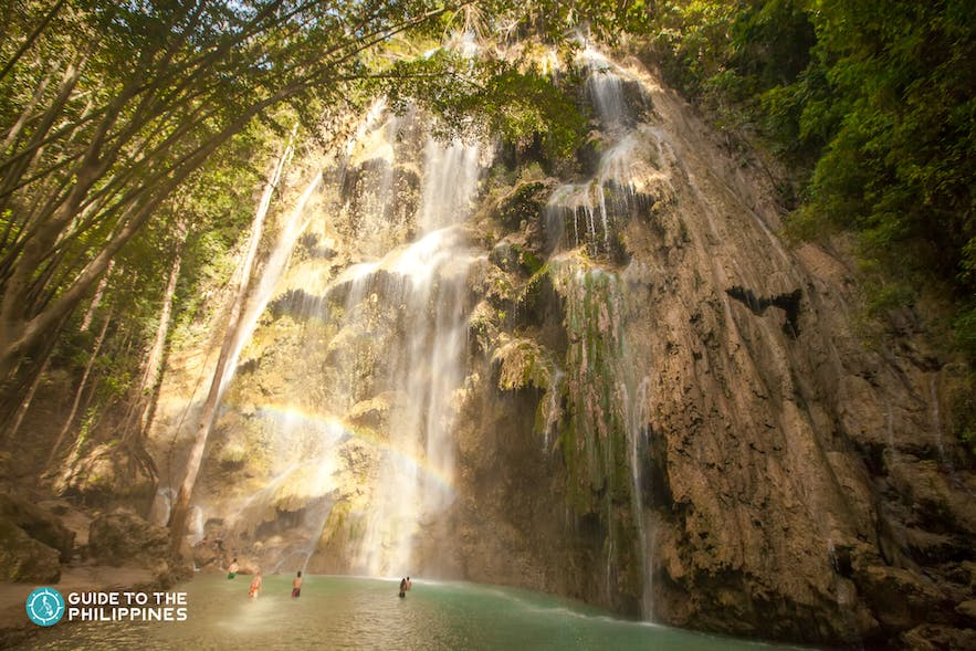 People enjoying the Tumalog falls in Oslob, Cebu