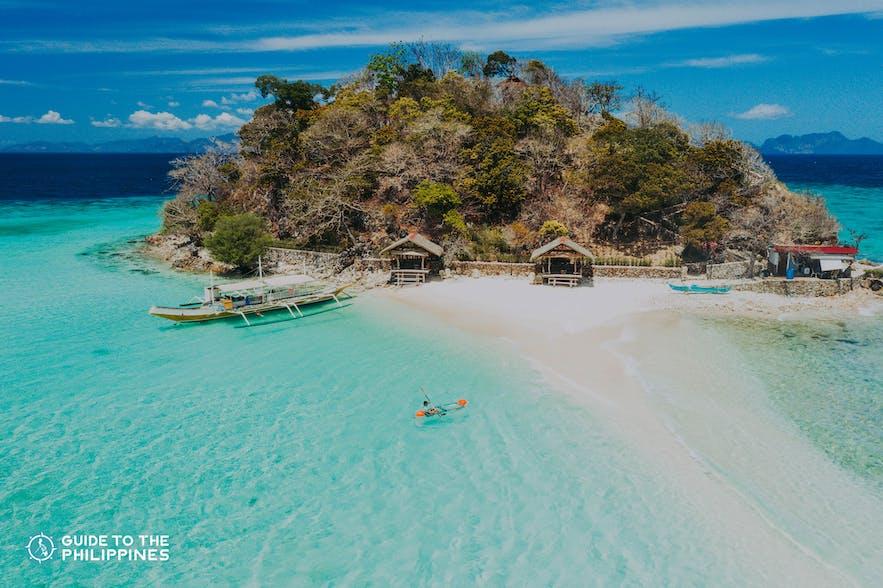 Aerial shot of a traveler kayaking at Bulog Dos Island in Coron, Palawan