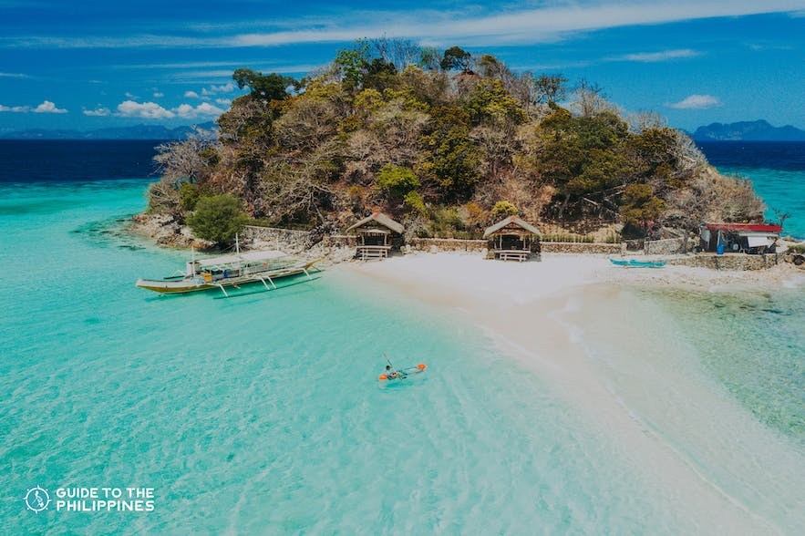 Aerial shot of a traveler kayaking at Bulog Dos Island in Coron, Palawan