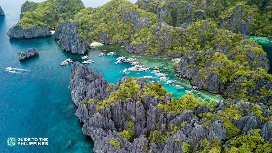 Aerial view of El Nido's limestone karsts and clear blue waters at Small Lagoon