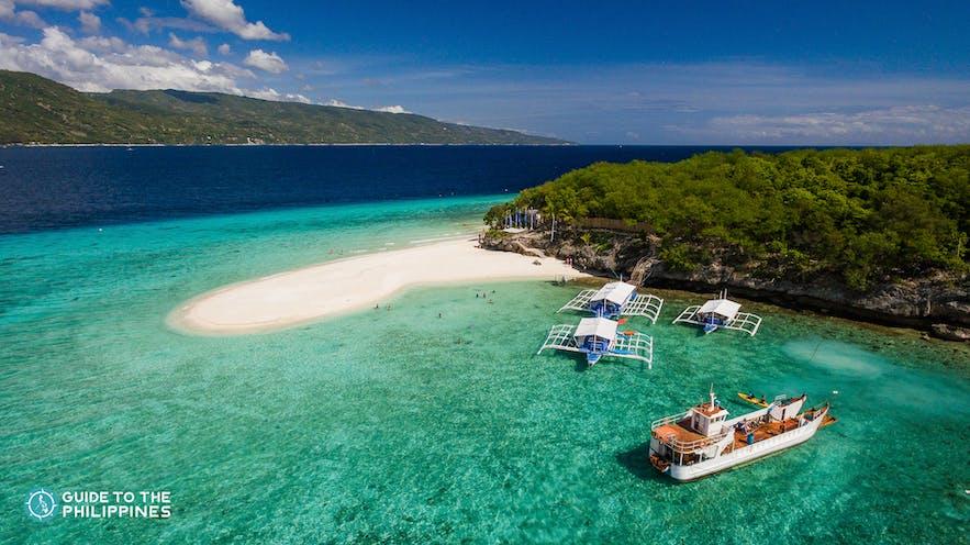 Boats serving travelers in Sumilon Island, Oslob, Cebu